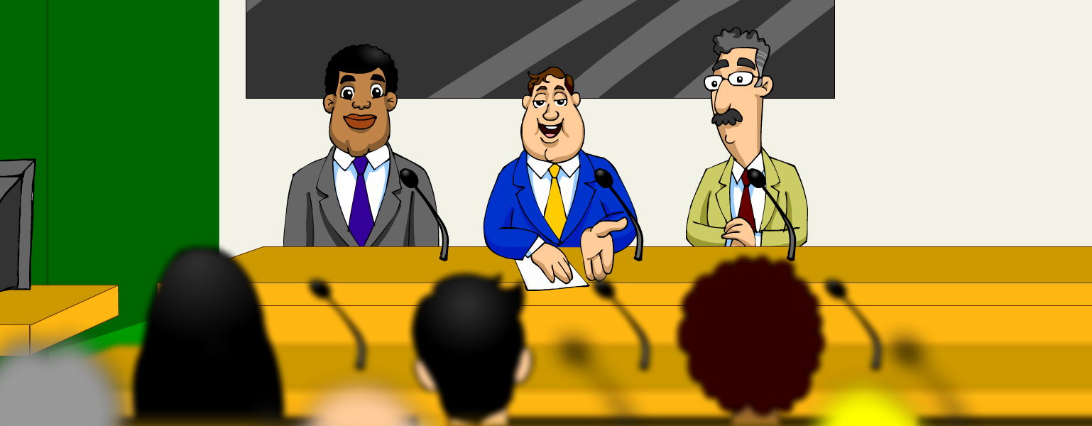 Ilustração. Ao fundo, vê-se uma faixa em tons de cinza sobre uma parede creme. Do lado direito, uma parede verde. Ao centro, três homens estão sentados à mesa, olhando para uma platéia. O homem à esquerda é moreno, cabelos curtos e encaracolados, lábios grossos. Ele veste um terno cinza, camisa branca e gravata roxa. Ao seu lado direito, falando, um outro homem de cabelos negros, curtos e pele clara. Ele veste um terno azul, camisa branca e gravata amarela. Ele está com uma mão apoiada na mesa e a outra um pouco levantada, com a palma virada para cima. Ele está falando. Ao seu lado direito, um homem de cabelos grisalhos, curtos e bigodes. Ele usa óculos. Veste terno verde, camisa branca e gravata vermelha. Diante deles, vê-se três cabeças. É a platéia que está virada para eles. Uma pessoa de cabelos pretos e longos, uma de cabelos curtos e castanhos e uma de cabelos curtos encaracolados.