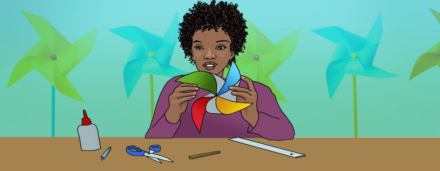 Ilustração. Fundo verde com desenhos de cata-ventos. Ao centro da imagem, uma mulher negra com olhos pretos, cabelo curto e cacheado, veste uma blusa roxa. Ela está sentada em uma mesa marrom, segurando um cata-vento colorido. Da esquerda para a direita, sobre a mesa tem uma cola, giz de cera, tesoura, palito e régua, todos sobre a mesa.